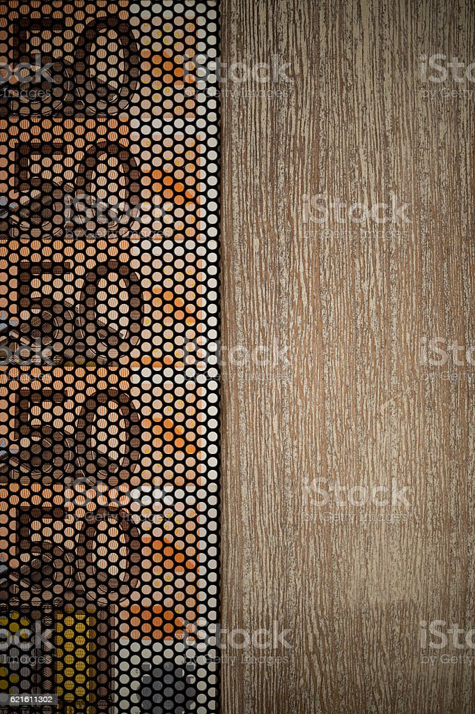50 euro bank notes behind wire mesh on wooden table stock photo