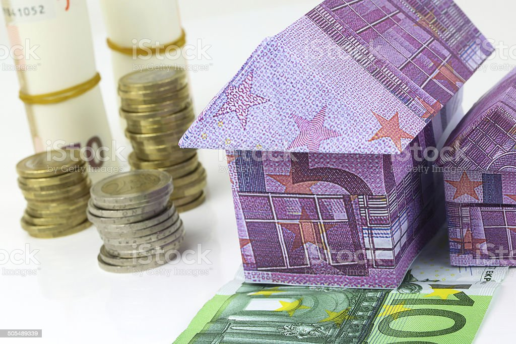 Euro bank notes House and coins royalty-free stock photo