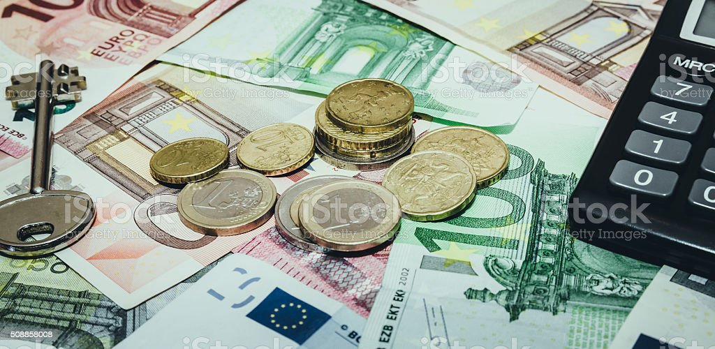 euro banknote and coins with house key. toned image stock photo
