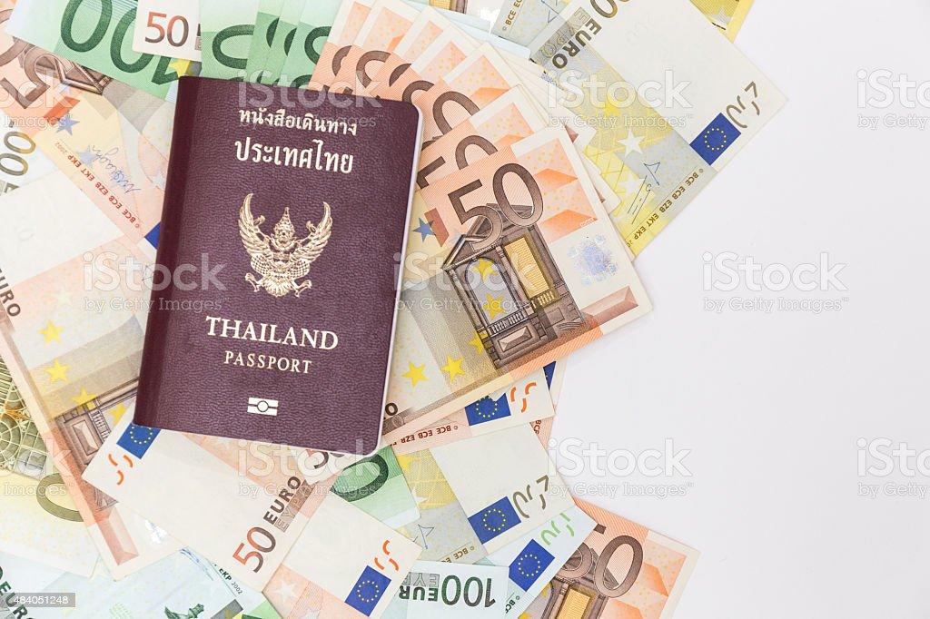 euro banknotes and thai passport stock photo