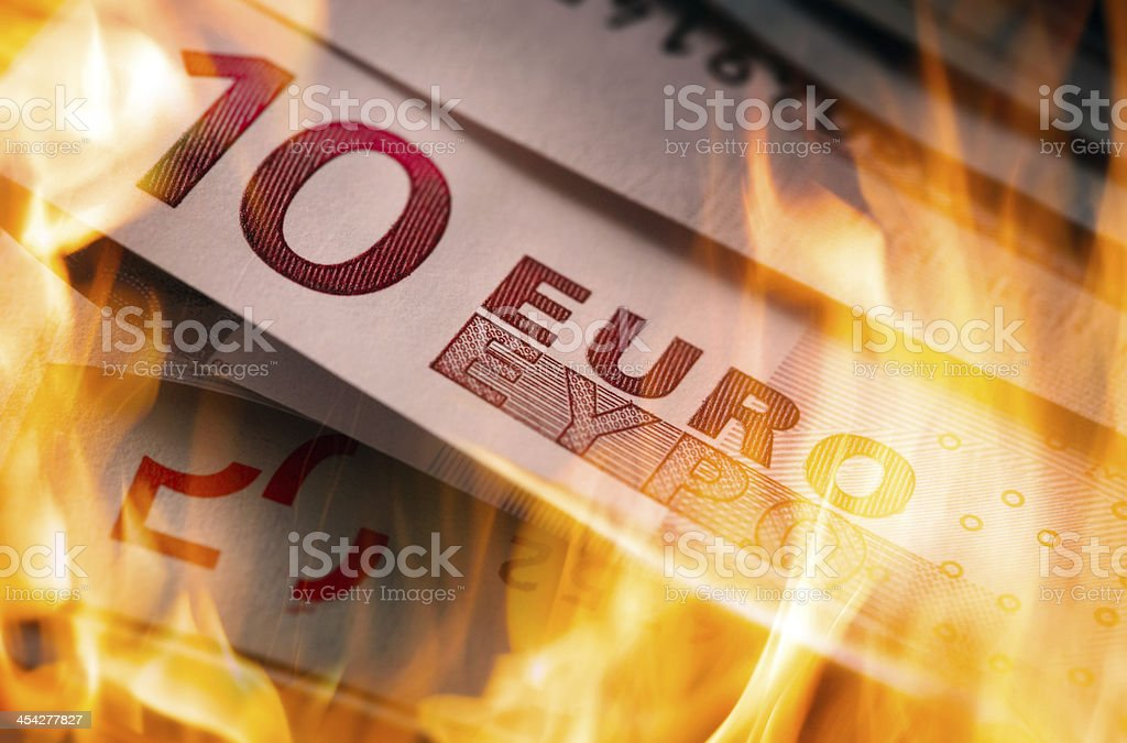 euro banknotes burning stock photo