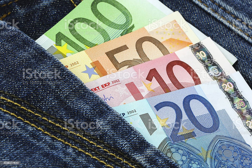 Euro banknotes in jeans pocket royalty-free stock photo