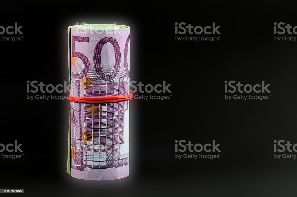 Euro banknotes rolled up with bright edges. Selective focus. stock photo