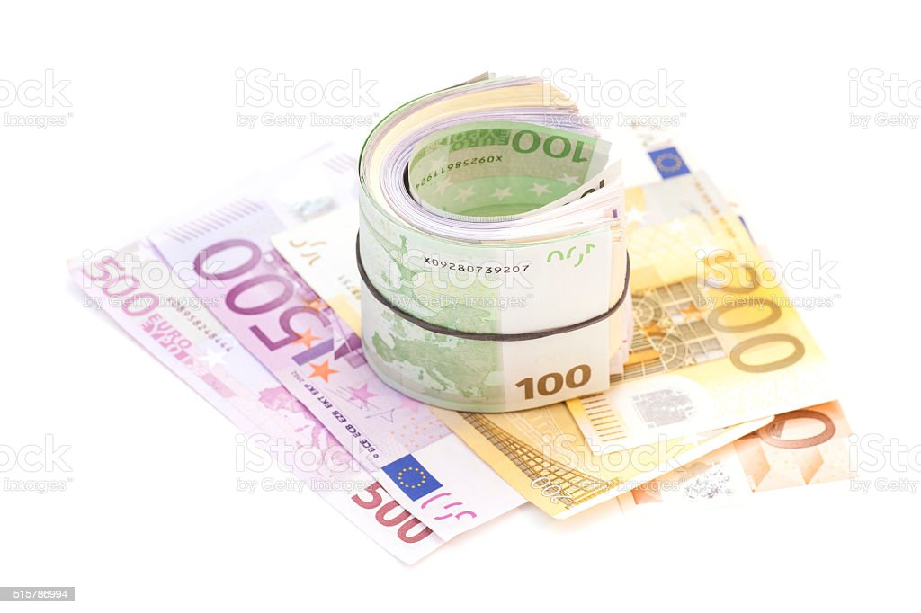 Euro banknotes under rubber band on banknotes stock photo