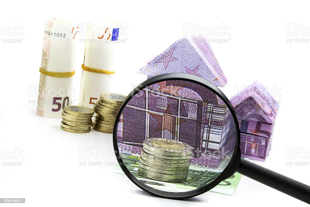 Euro bill House and expenses under magnifying glass royalty-free stock photo