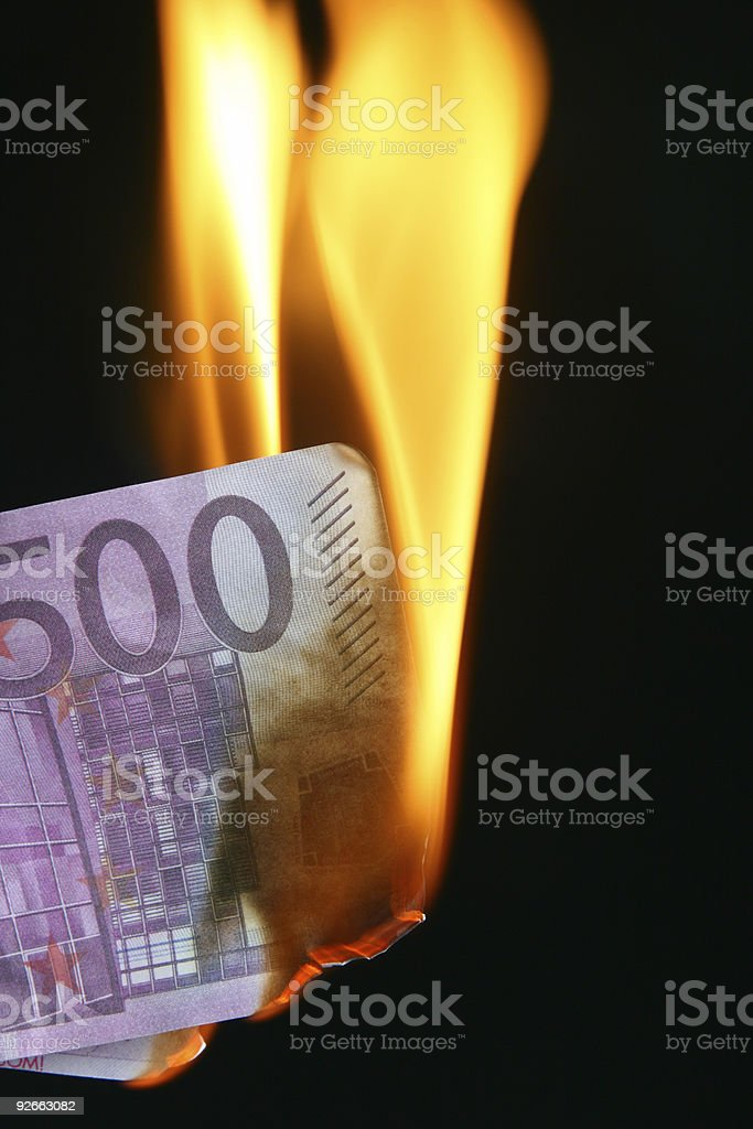 Euro bill on fire royalty-free stock photo