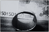 Euro bills tied with rubber band