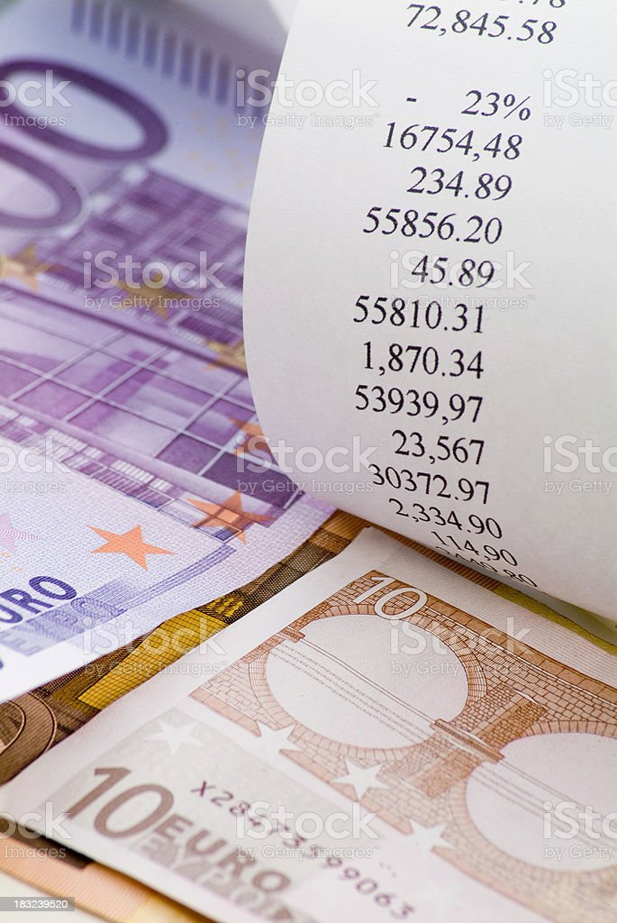 Euro bills with adding machine tape stock photo