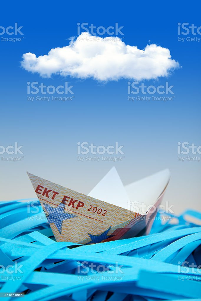 Euro Boats on shredded paper royalty-free stock photo