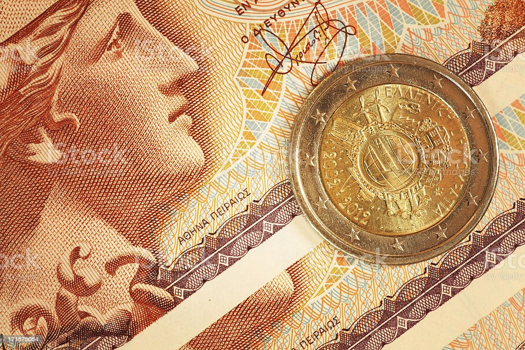 Euro Cent Coin on Greek Drachma Notes | Finance, Business stock photo