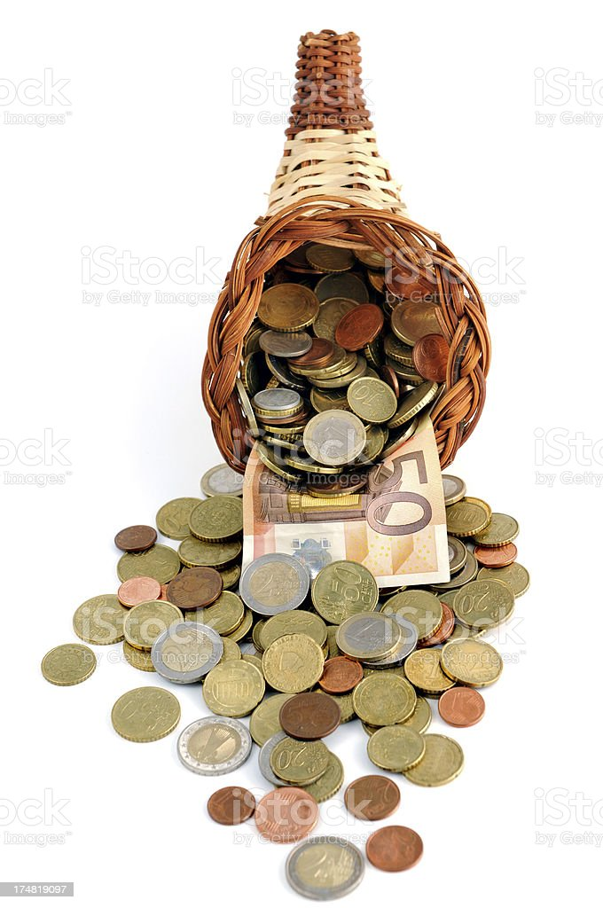 Euro coin and 50 paper currency falling out of cornucopia royalty-free stock photo