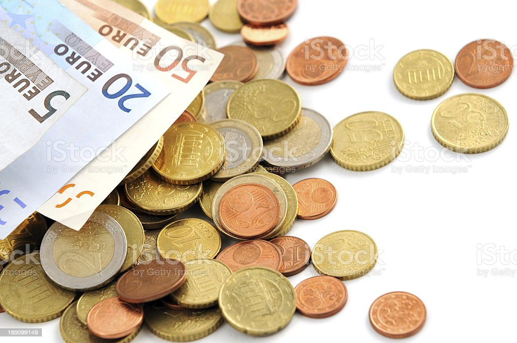 Euro coin and paper currency falling on white background stock photo