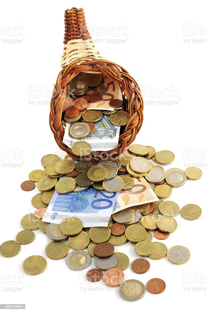 Euro coin and paper currency falling out of cornucopia stock photo