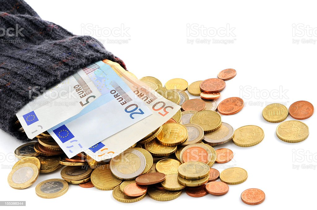 Euro coin and paper currency falling out of money sock stock photo