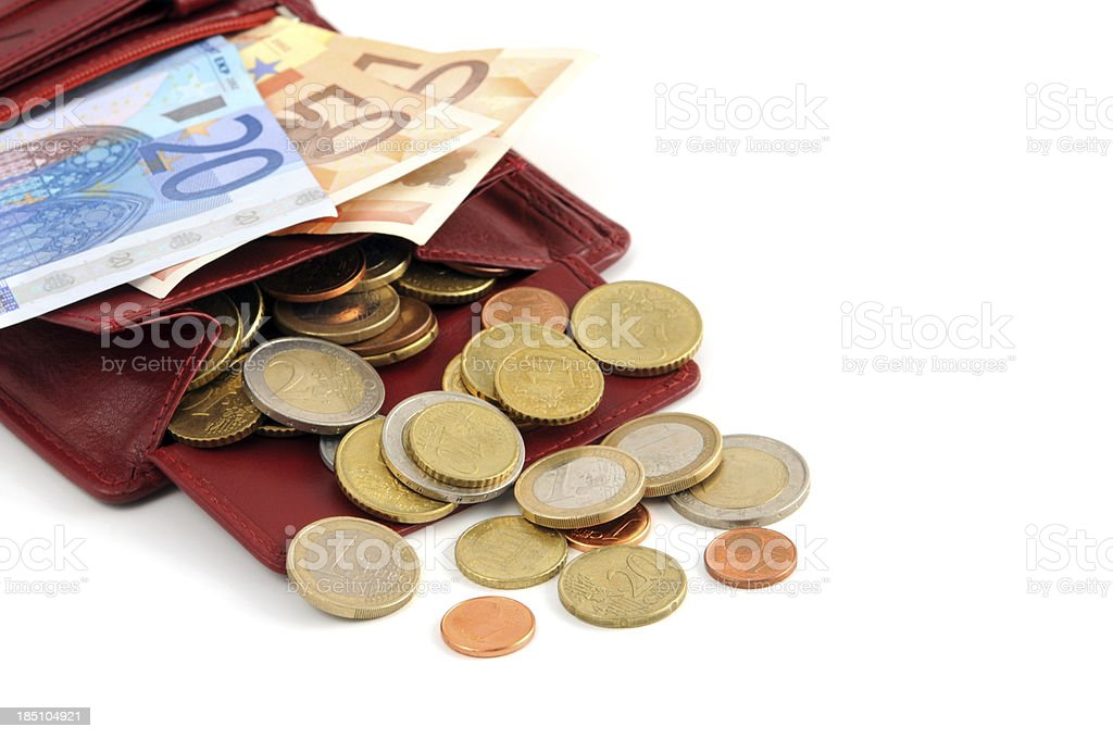Euro coin and paper currency falling out of wallet stock photo