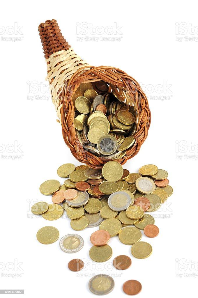 Euro coin falling out of cornucopia stock photo