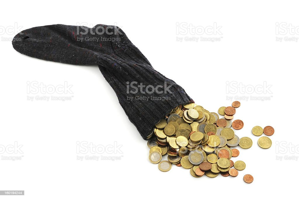 Euro coin falling out of money sock stock photo