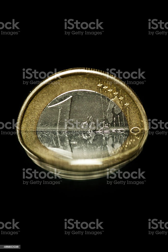 Euro coin in rising water stock photo