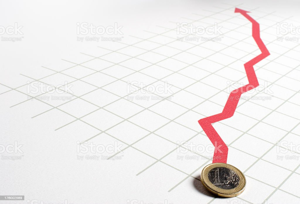 Euro coin on chart showing growth and success royalty-free stock photo