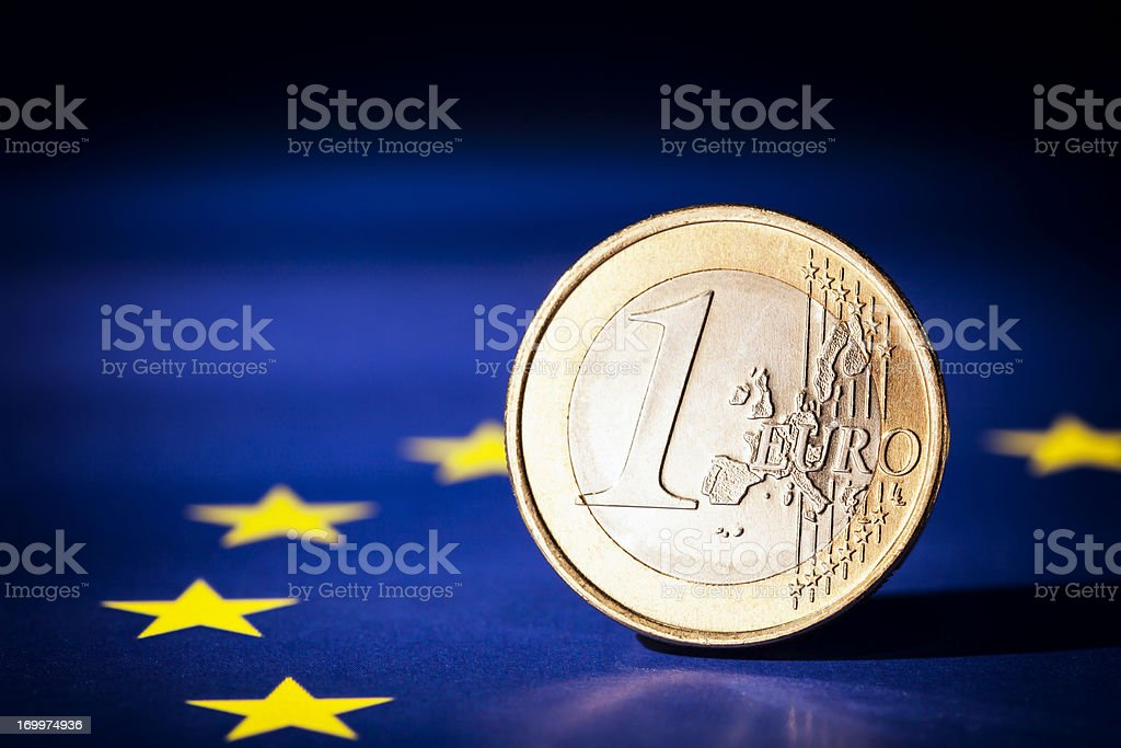 Euro Coin On European Union Flag royalty-free stock photo