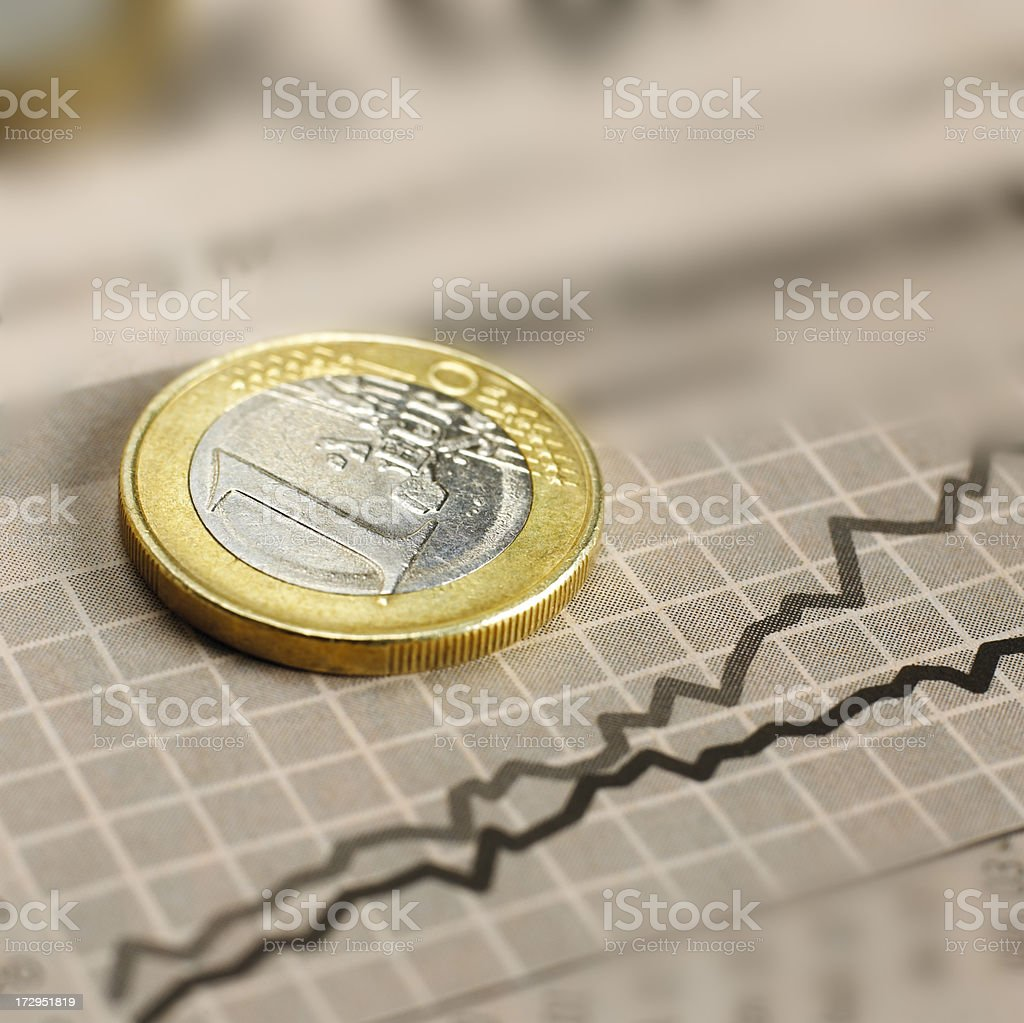 Euro coin on graph royalty-free stock photo