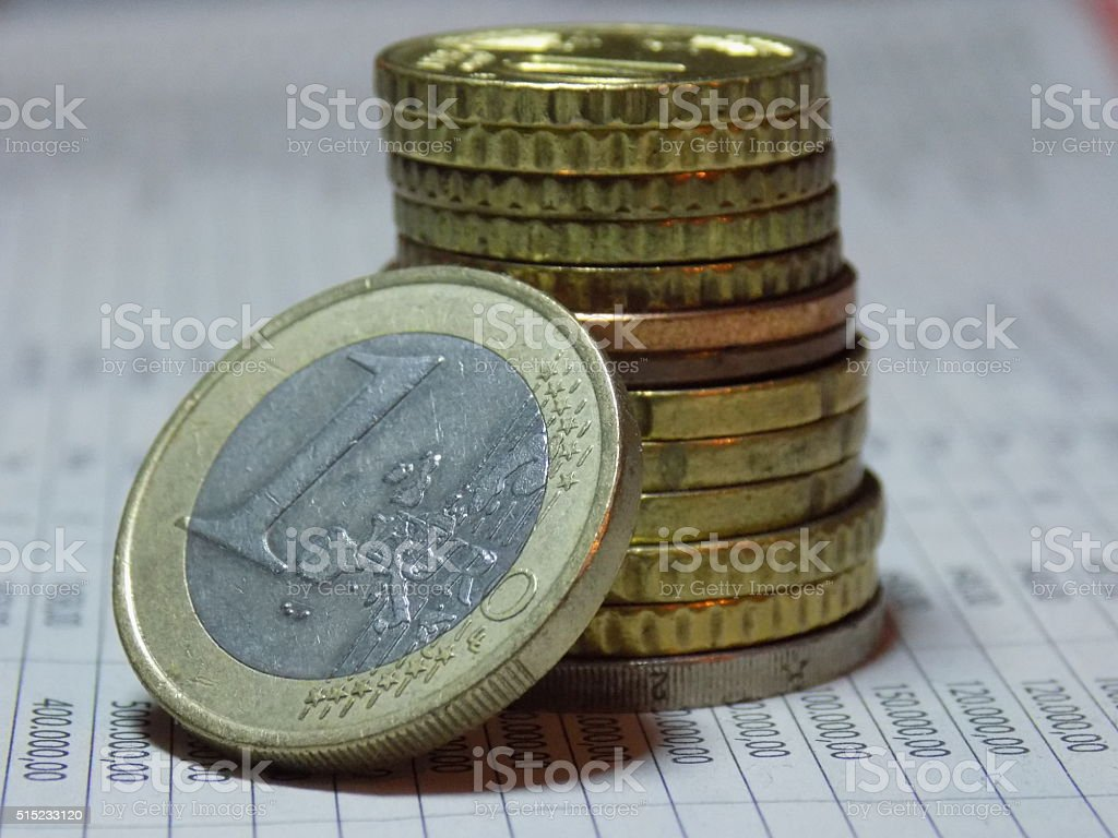Euro coin pile on financial paper stock photo