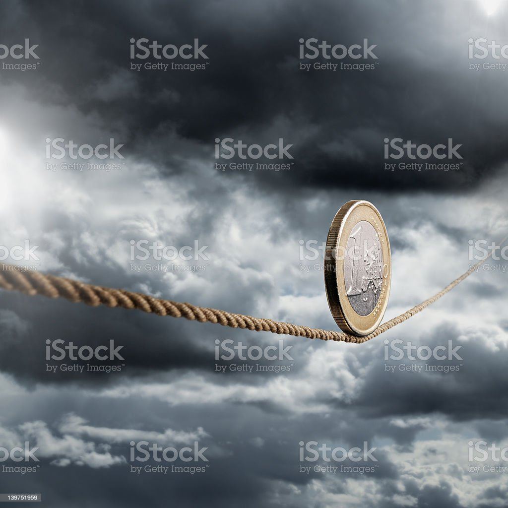 1 euro coin rolling unto a rope stock photo