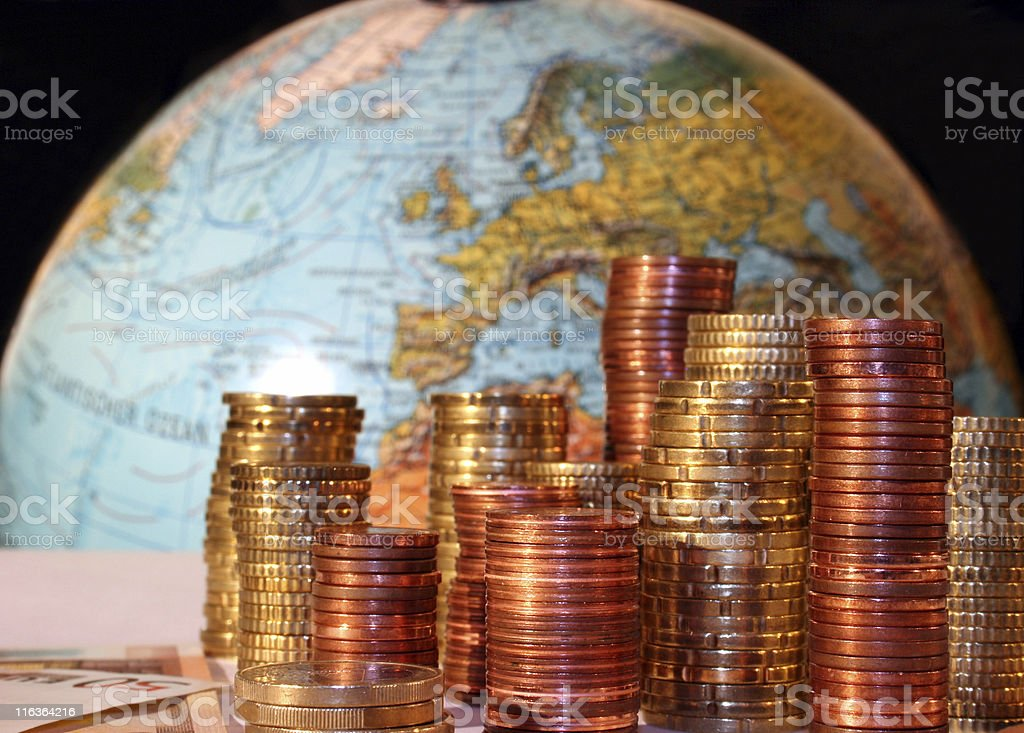 Euro coins & Europe on a globe - Eurom?nzen & Europa stock photo