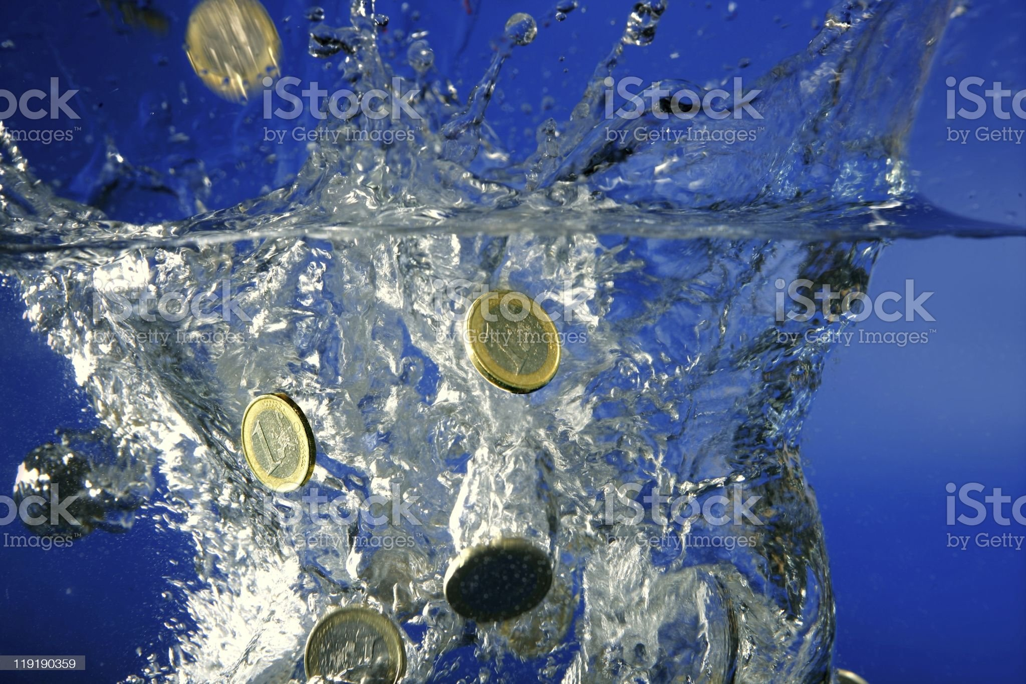 Euro coins falling down to water royalty-free stock photo