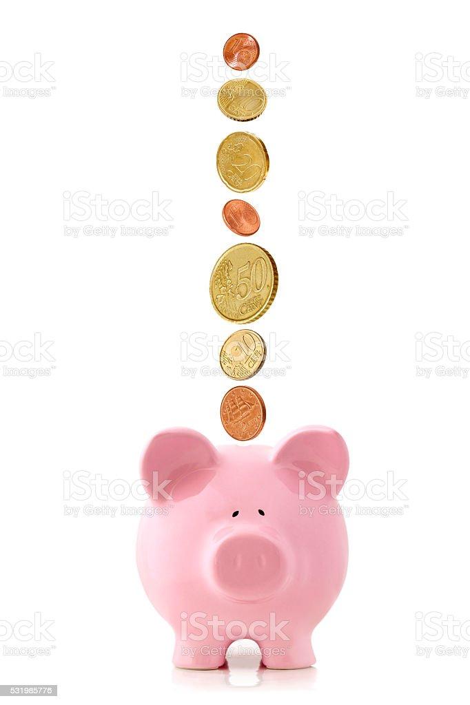 Euro Coins Falling into Piggy Bank stock photo