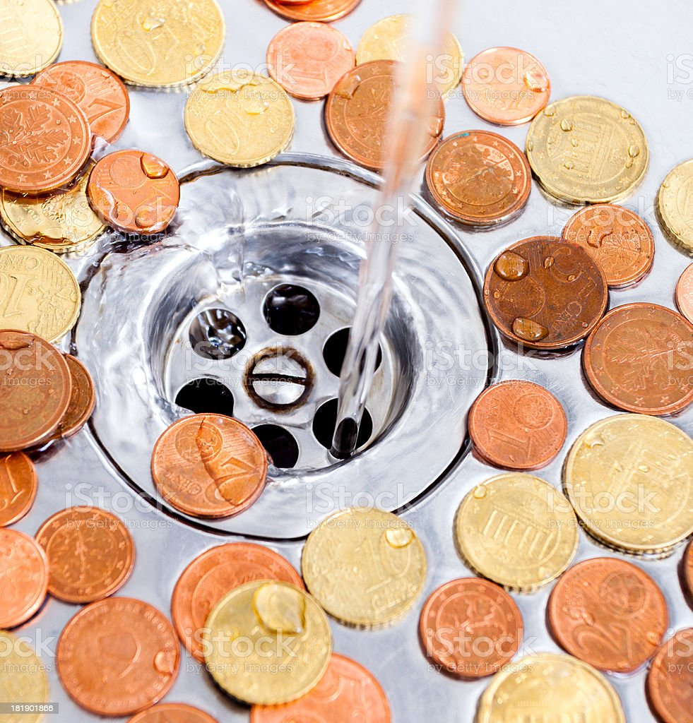 euro coins in a sink royalty-free stock photo