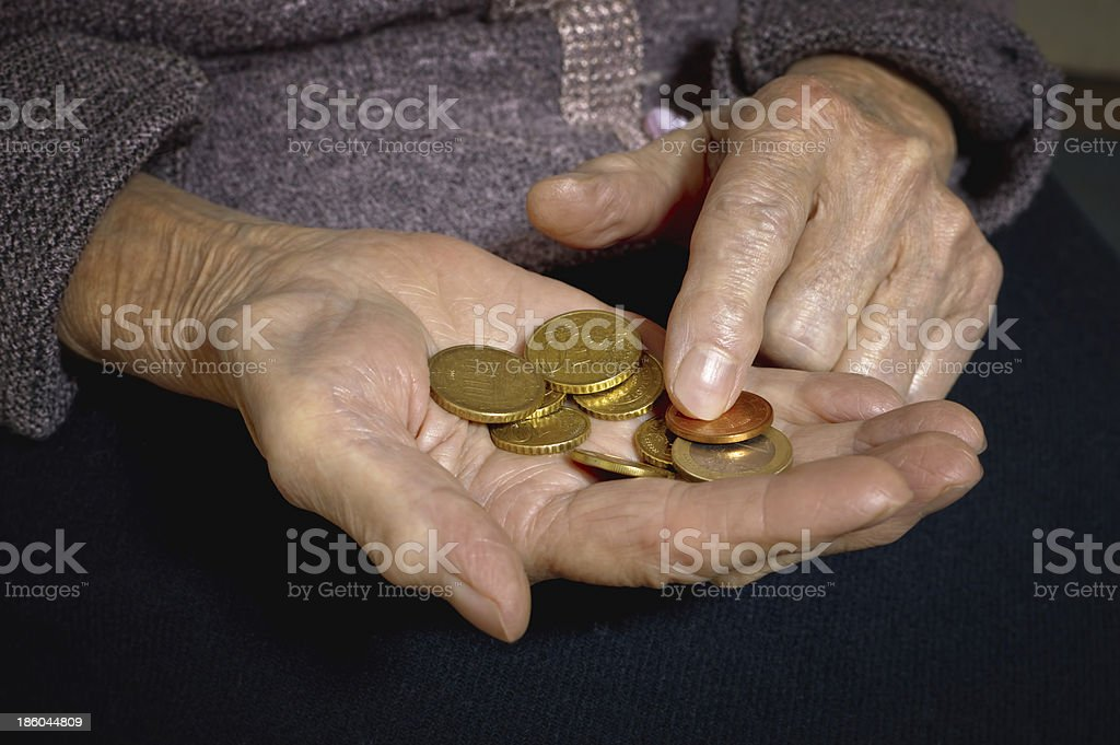 Euro coins in old woman's hands. royalty-free stock photo