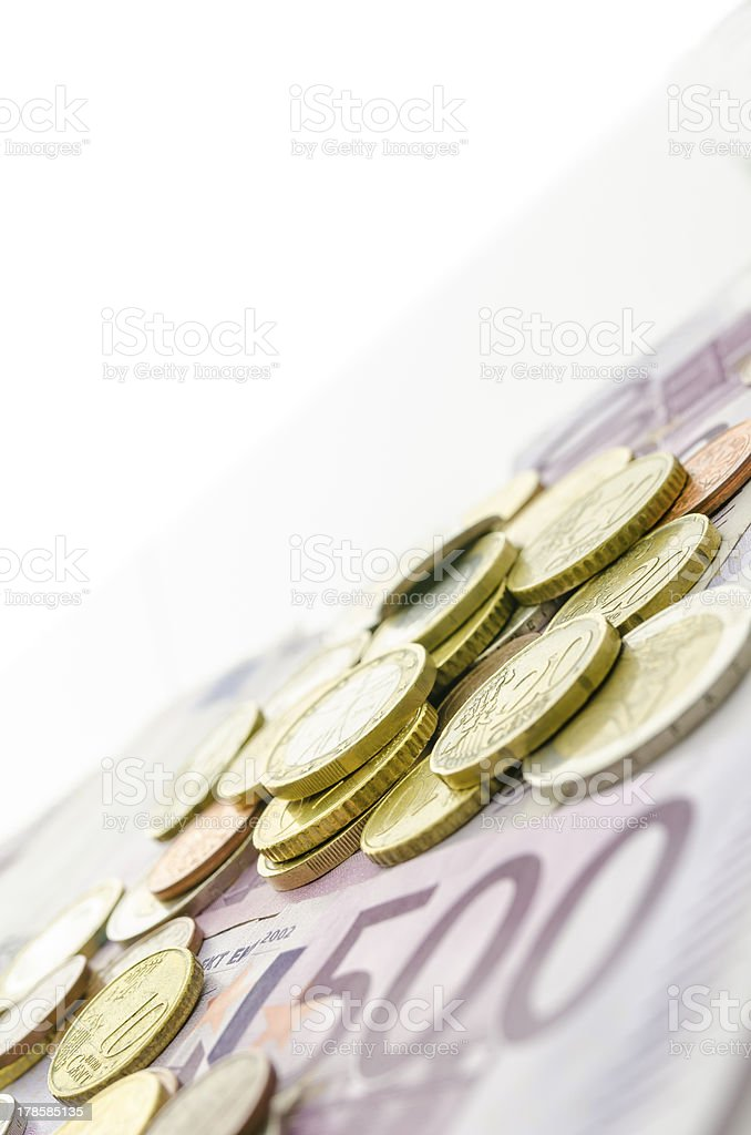Euro coins on banknotes royalty-free stock photo