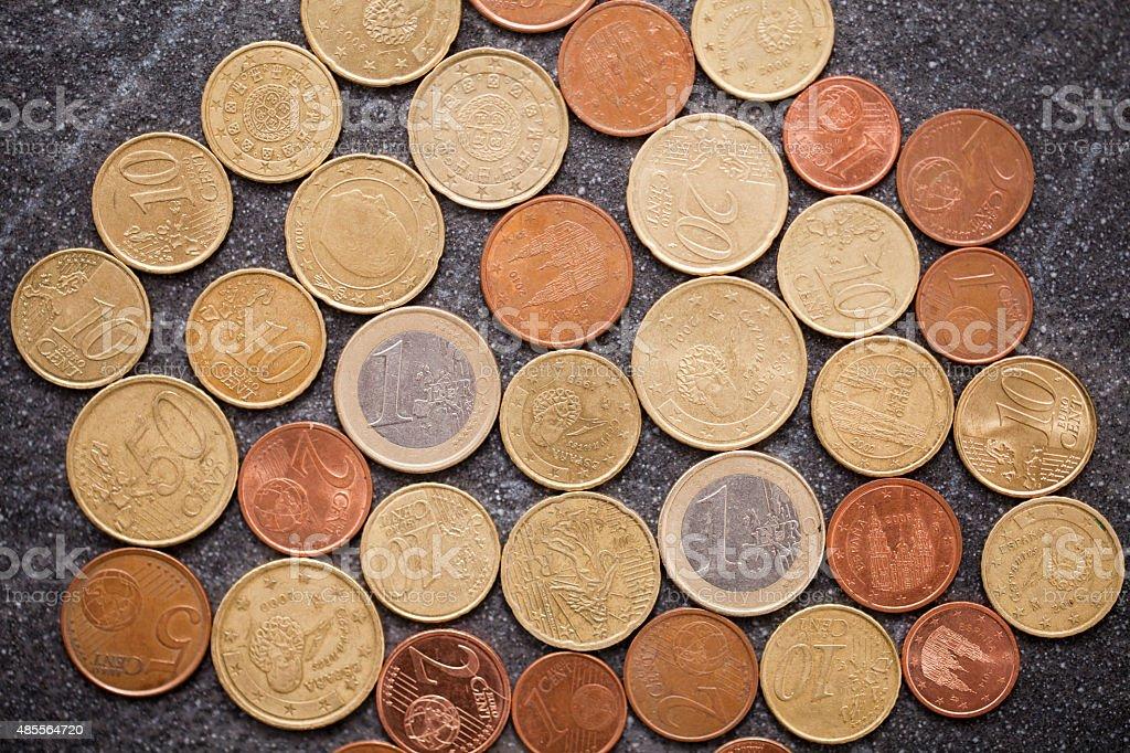 Euro coins on black slate. stock photo