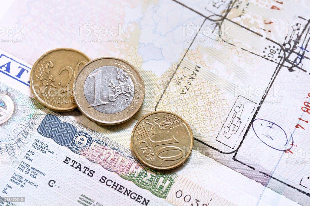 Euro coins on passport with greek European Union visa stock photo