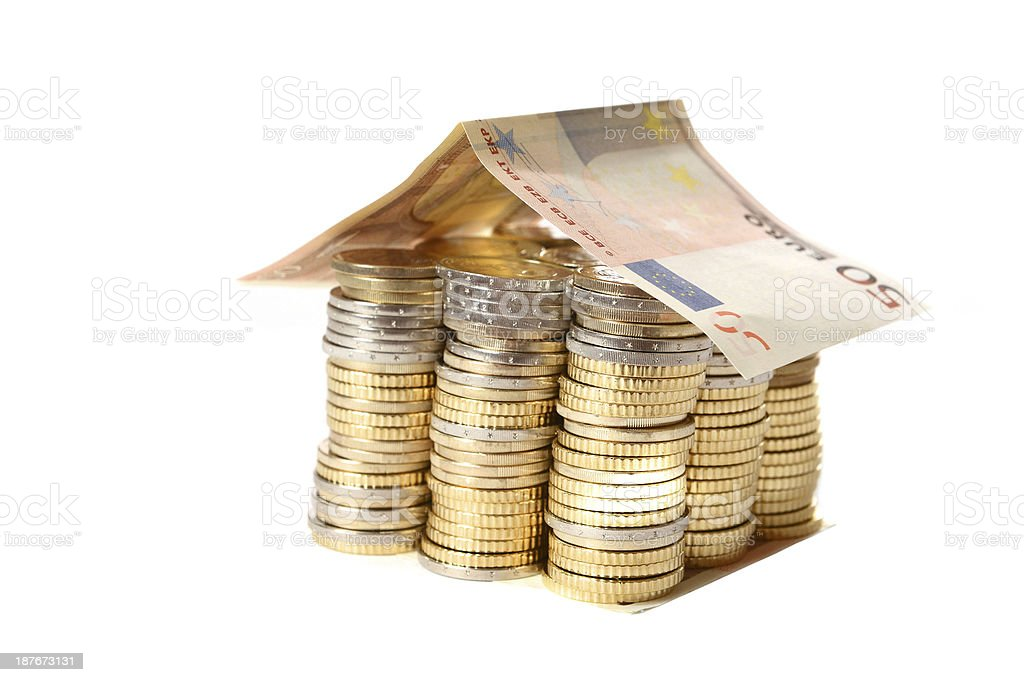 Euro Coins pile House with banknote roof royalty-free stock photo