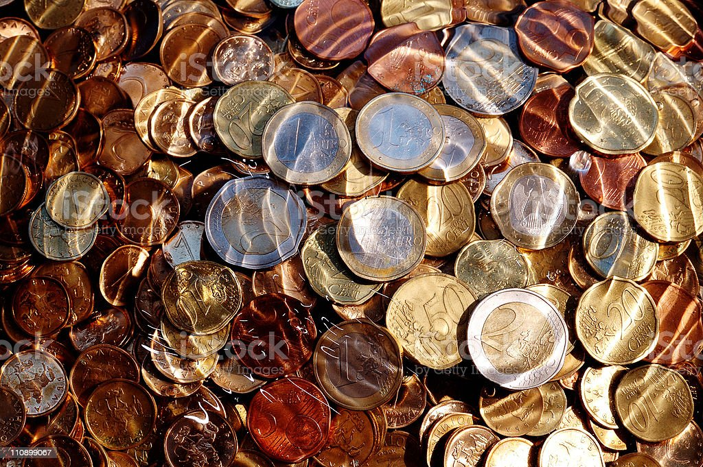 euro coins under water royalty-free stock photo