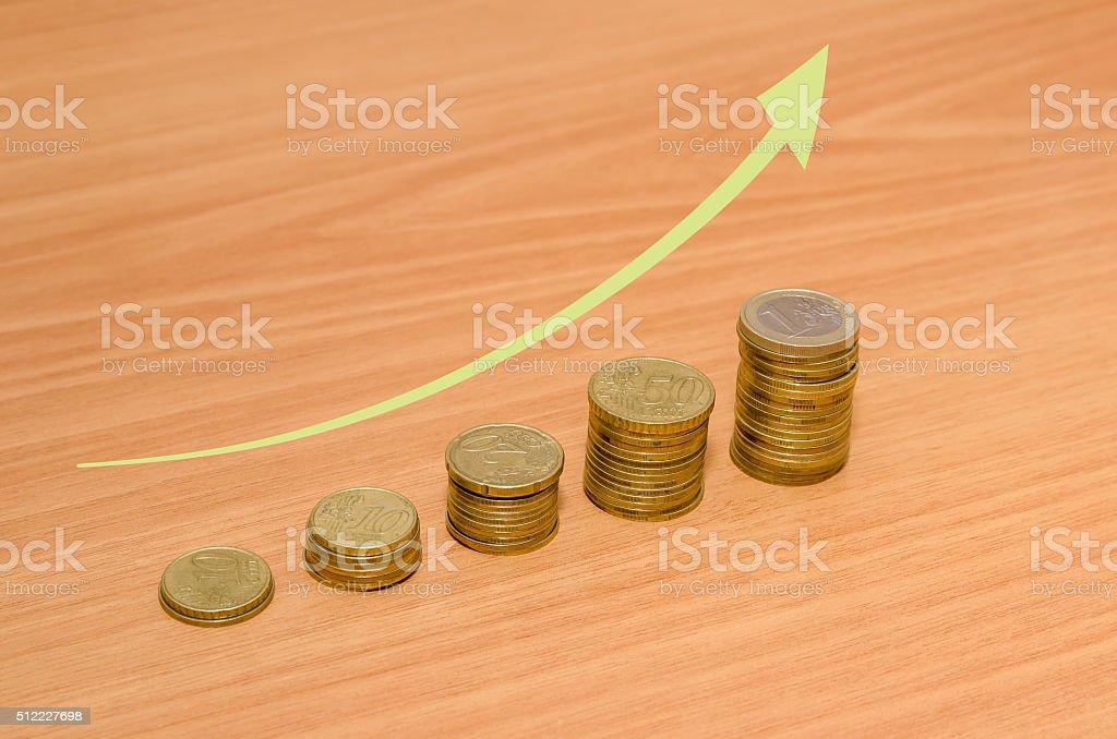 Euro coins with arrow stock photo