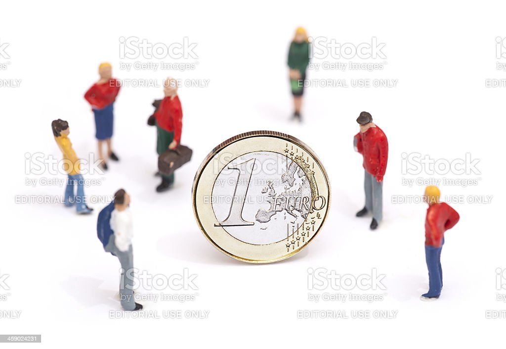 Euro crisis concept : miniature persons standing around coin royalty-free stock photo