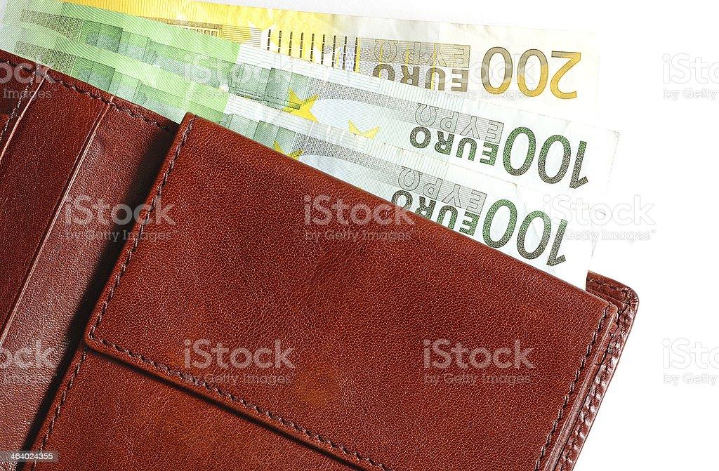 Euro currency bills in brown wallet