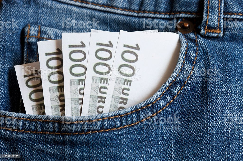 euro in the jeans pocket stock photo