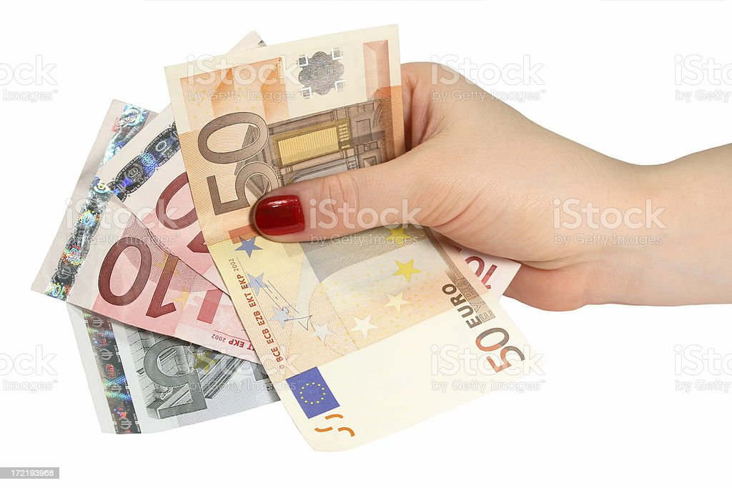 Euro in woman's hand (isolated) royalty-free stock photo