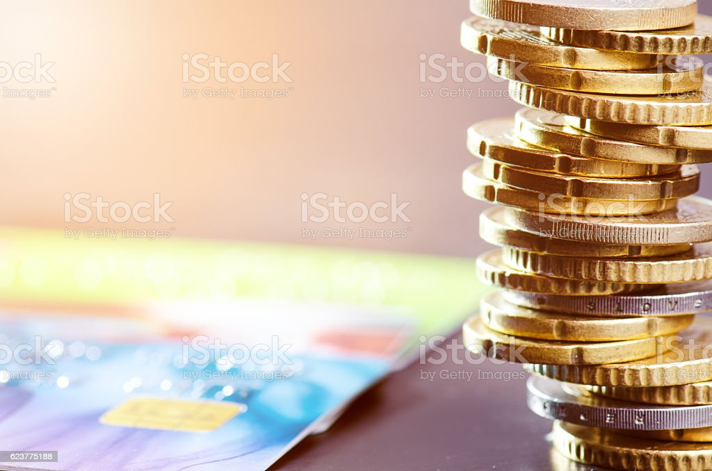 Euro money. Coins with credit cards stock photo
