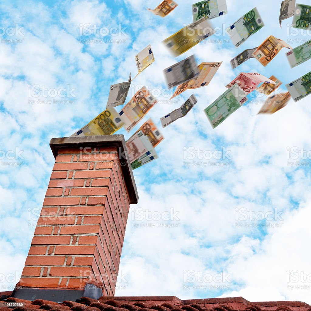euro money flies down the chimney stock photo