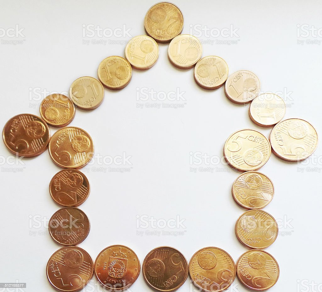 Euro money home - eurocents and coins stock photo
