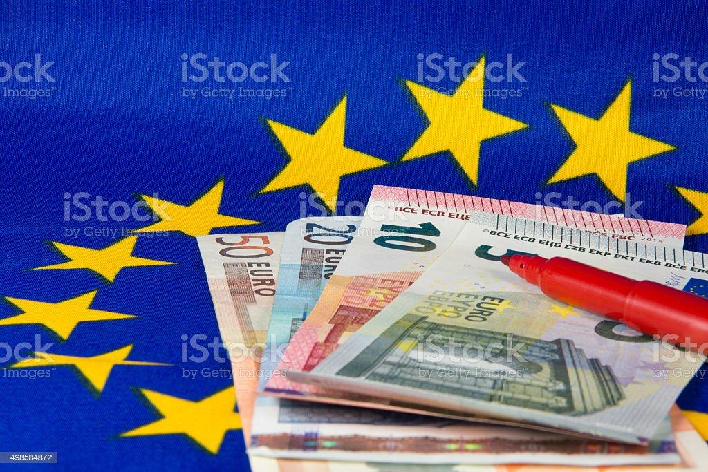Euro notes and red pencil, EU flag stock photo