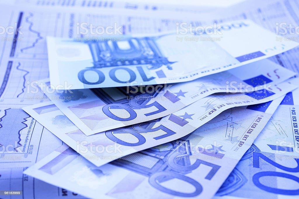 Euro notes on a financial newspaper stock photo