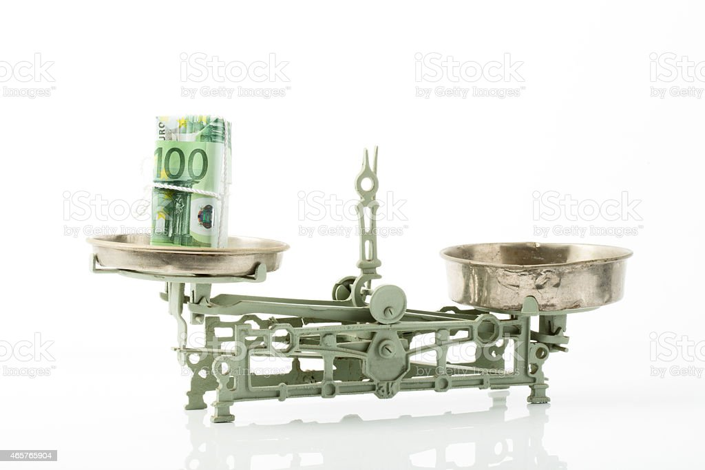 100 Euro notes on scales stock photo