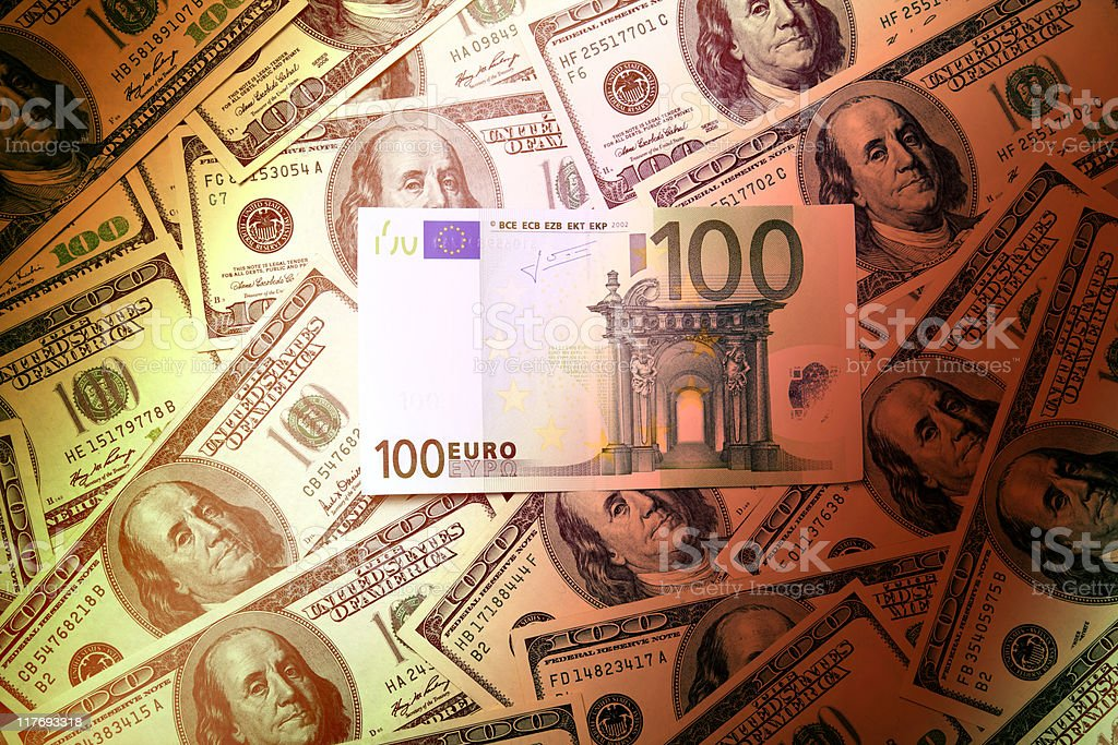 Euro on hundred greenbacks pile stock photo