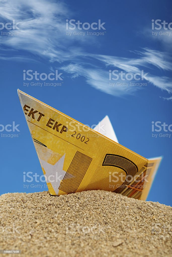 Euro Paper boats on the sand royalty-free stock photo
